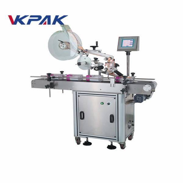 Automatický stroj na nanášanie štítkov na ploché povrchy pre vrecká